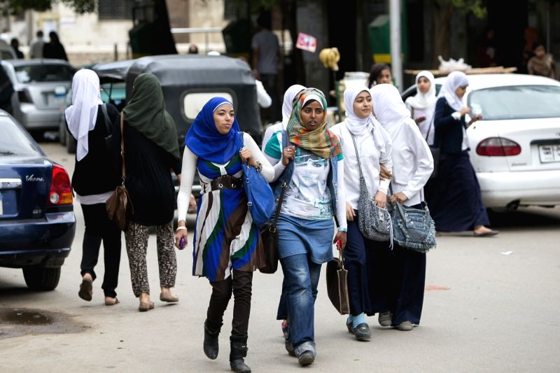 Photo: Egyptian women walk on street in Cairo, Egypt, May 8, 2014. Egypt's cabinet approved on Wednesday a new anti-sexual harassment law, the first of its kind in ...