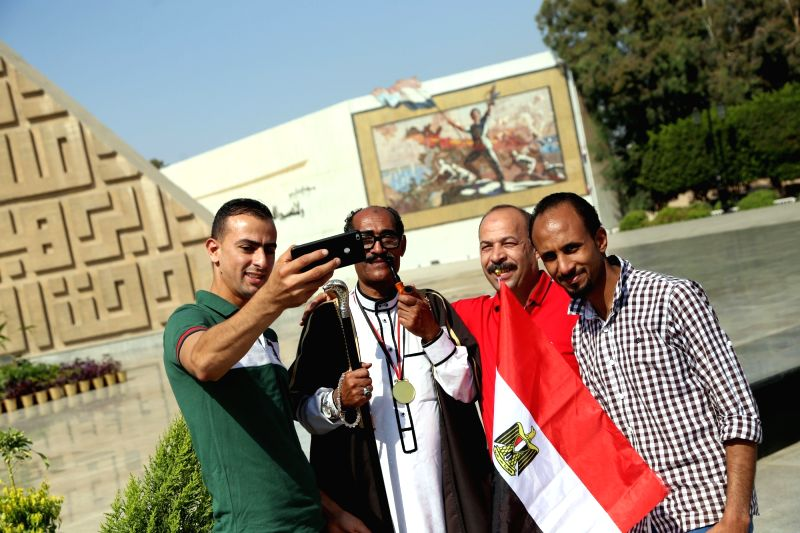 CAIRO, Oct. 6, 2017 - People take selfies at the Sadat Memorial on the occasion of the 44th anniversary of the October War in 1973, in Cairo, Egypt, on Oct. 6, 2017.