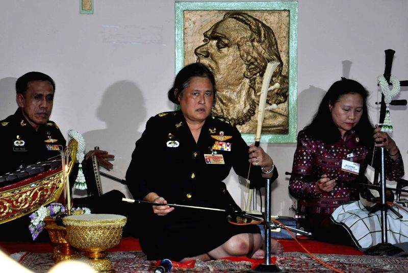 Thai Princess Maha Chakri Sirindhorn (C) plays a traditional Thai musical instrument during her visit at Rabindra Bharati University in Calcutta, capital of ...