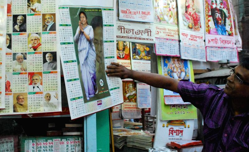 Calendars depicting pictures of different political leaders on display at a workshop in Kolkata on April 11, 2014.