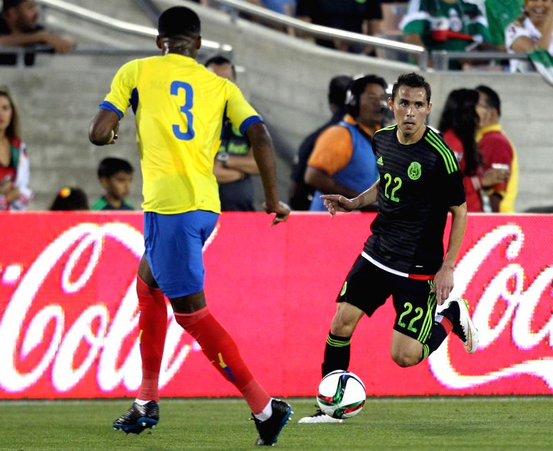 Mexico's Paul Aguilar (R) competes during the international friendly match against Ecuador, held in the Los Angeles Memorial Coliseum, in Los Angeles city, ...