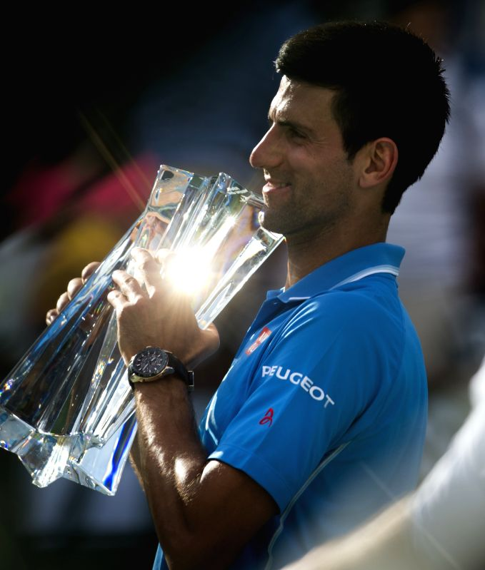 Serbian tennis player Novak Djokovic with the trophy after defeating his Swiss counterpart Roger Federer in the finals of the BNP Paribas Open tennis at the Indian Wells Tennis Garden in ...