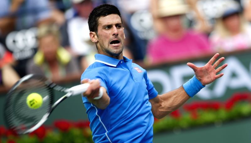 Serbian tennis player Novak Djokovic in action against his Swiss counterpart Roger Federer in the finals of the BNP Paribas Open tennis at the Indian Wells Tennis Garden in California, US ...