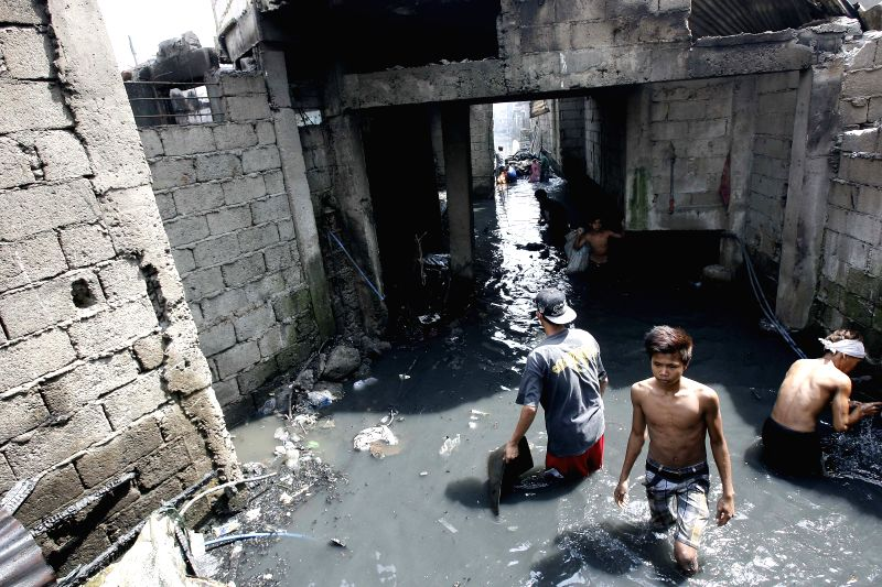 Residents look for their reuseable belongings after a fire hit a slum area in Caloocan City, the Philippines on April 21, 2014. Around 1,000 families were ...