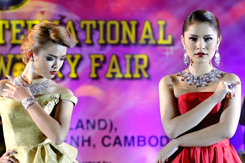 Cambodian models show jewelry during a gems and jewelry exhibition in Phnom Penh, Cambodia, July 23, 2015. The annual gems and jewelry fair kicked off here on ...