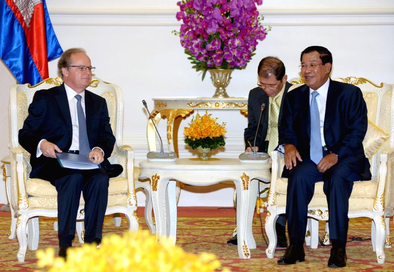 Cambodian Prime Minister Hun Sen (R) meets with World Bank Vice President for the East Asia and the Pacific region Axel van Trotsenburg in Phnom Penh, Cambodia, ... - Hun Sen