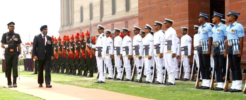 Canada Defence Minister Harjit Singh Sajjan reviews the Tri-Services Guard of Honour, in New Delhi on April 18, 2017. - Harjit Singh Sajjan