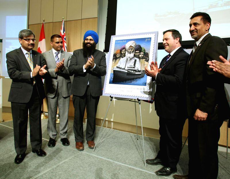 Canada Post president and CEO, Deepak Chopra, Canadian Minister for Employment Jason Kenney, Canadian Minister for Multiculturalism Tim Uppal and Canadian Minister of Sports Bal Gosal unveil a stamp . - Deepak Chopra