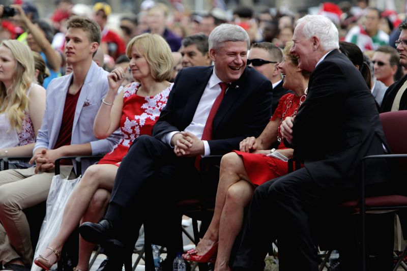 Canada's Prime Minister Stephen Harper (3rd R) shares a laugh with Governor General David Johnston (1st R) and his wife Sharon (2nd R) during Canada Day festivities ... - Stephen Harper