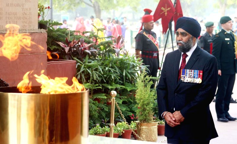 Canadian Defence Minister Harjit Singh Sajjan pays tribute at Amar Jawan Jyoti, India Gate in New Delhi on April 18, 2017. - Harjit Singh Sajjan