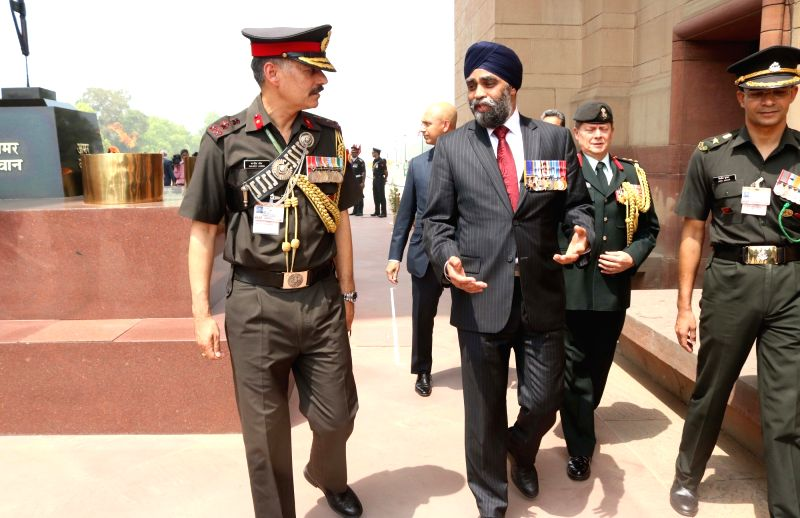 Canadian Defence Minister Harjit Singh Sajjan visits India Gate in New Delhi on April 18, 2017. - Harjit Singh Sajjan