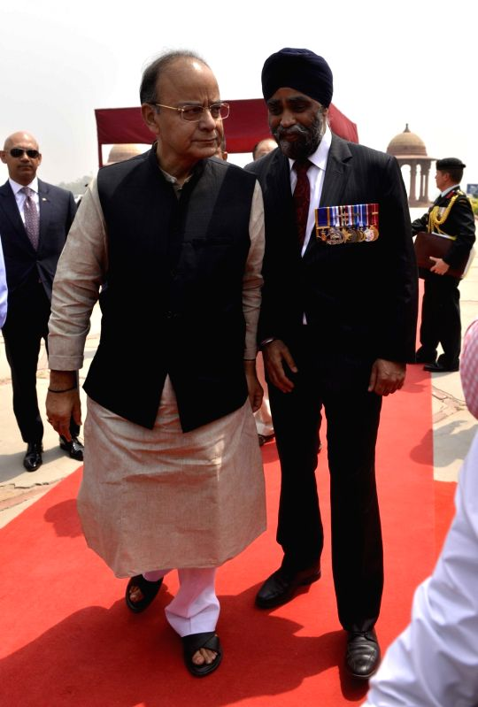 Canadian Defence Minister Harjit Singh Sajjan being welcomed by Union Defence Minister Arun Jaitley at South Block in New Delhi on April 18, 2017. - Harjit Singh Sajjan and Arun Jaitley