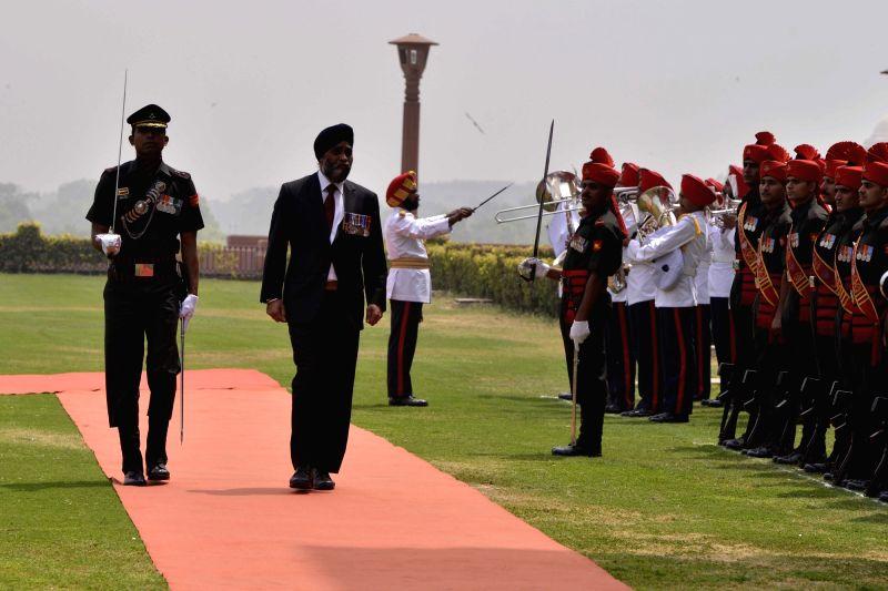 Canadian Defence Minister Harjit Singh Sajjan inspects guard of honour at South Block in New Delhi on April 18, 2017. - Harjit Singh Sajjan