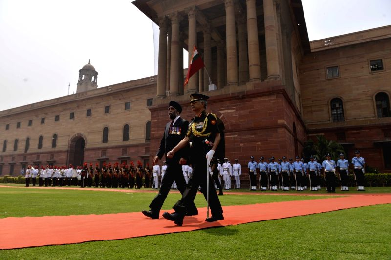 Canadian Defence Minister Harjit Singh Sajjan inspects guard of honour at South Block in New Delhi on April 18, 2017. - Harjit Singh Sajjan