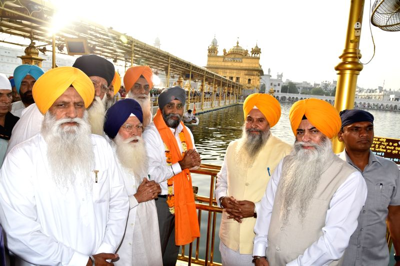 Canadian Defence Minister Harjit Singh Sajjan pays obeisance at the Golden Temple in Amritsar on April 20, 2017. - Harjit Singh Sajjan
