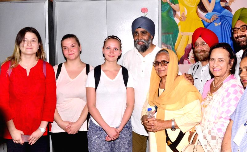 Canadian Defence Minister Harjit Singh Sajjan with the founder of Pingalwara Dr. Inderjit Kaur during his visit to Pingalwara in Amritsar on April 20, 2017. Pingalwara is a house for ... - Harjit Singh Sajjan and Inderjit Kaur