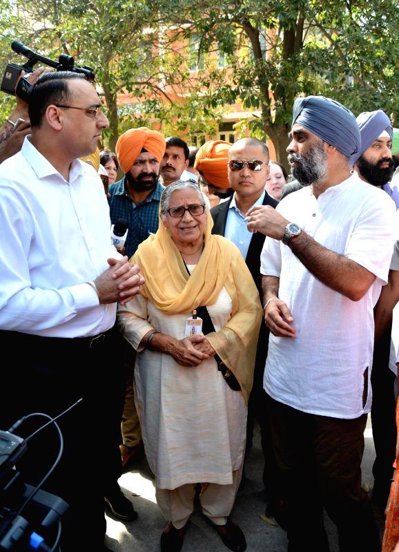 Canadian Defence Minister Harjit Singh Sajjan interacts with the founder of Pingalwara Dr. Inderjit Kaur during his visit to Pingalwara in Amritsar on April 20, 2017. Pingalwara is a house ... - Harjit Singh Sajjan and Inderjit Kaur