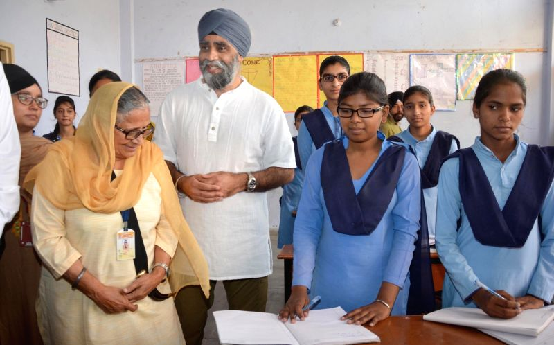 Canadian Defence Minister Harjit Singh Sajjan with the founder of Pingalwara Dr. Inderjit Kaur during his visit to a school at Pingalwara in Amritsar on April 20, 2017. Pingalwara is a ... - Harjit Singh Sajjan and Inderjit Kaur