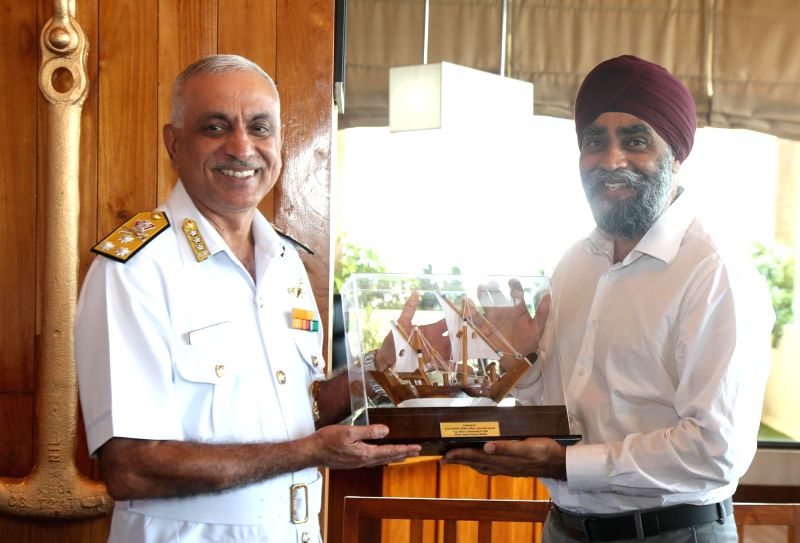 Canadian Defence Minister Harjit Singh Sajjan with Western Naval commander, Vice Admiral Girish Luthra during his visit to Western Naval Command in Mumbai on April 22, 2017. - Harjit Singh Sajjan