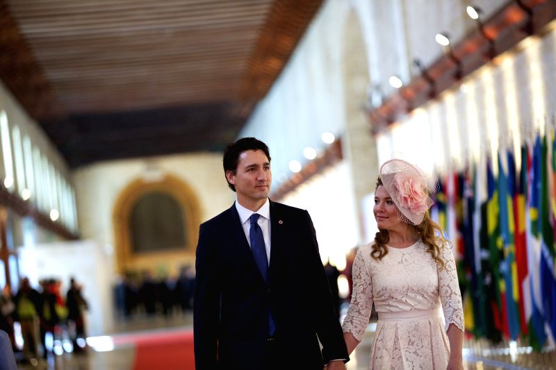 Canadian Prime Minister Justin Trudeau and his wife Sophie Gregoire arrive for the opening ceremony of the Commonwealth Heads of Government Meeting (CHOGM) in ... - Justin Trudeau