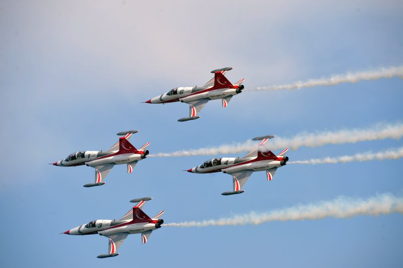 Aircrafts of aerobatic team perform during a ceremony marking the historic Gallipoli Battle in Canakkale, Turkey, on April 24, 2015. Turkish President Recep ...