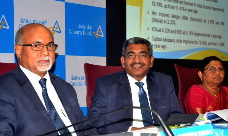 Canara Bank Managing Director and CEO Rakesh Sharma with Executive Directors Dina Harideesh Kumar and PV Bharathi addresses a press conference at Canara Bank Head Office in Bengaluru on ... - Rakesh Sharma and Dina Harideesh Kumar