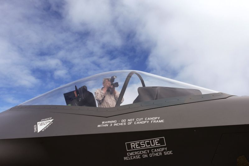 A man takes photos of a F-35 model shown at the Canberra Airport Open Day in Canberra, Australia, April 6, 2014. The Australian government has approved the ... - Tony Abbott