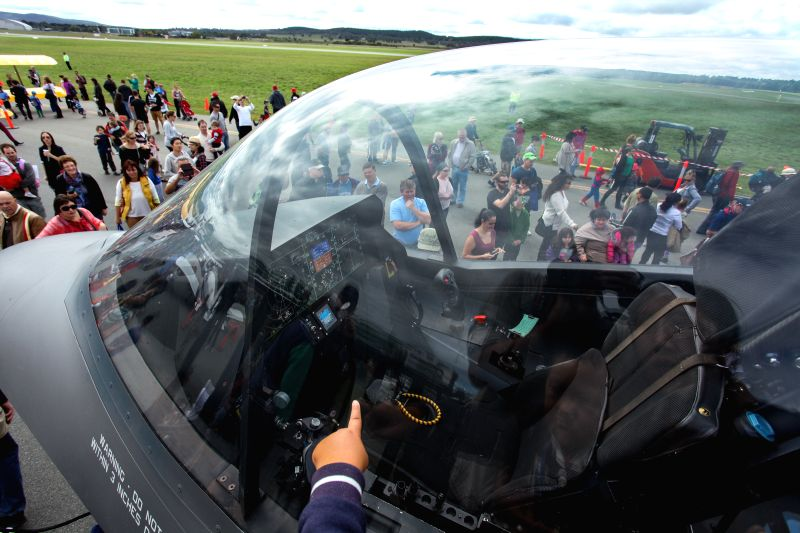 People look at a F-35 model shown at the Canberra Airport Open Day in Canberra, Australia, April 6, 2014. The Australian government has approved the acquisition .. - Tony Abbott