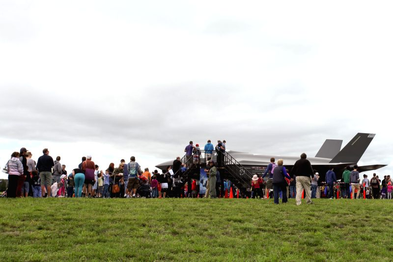 Visitors queue up to have a close look at a F-35 model shown at the Canberra Airport Open Day in Canberra, Australia, April 6, 2014. The Australian government has - Tony Abbott