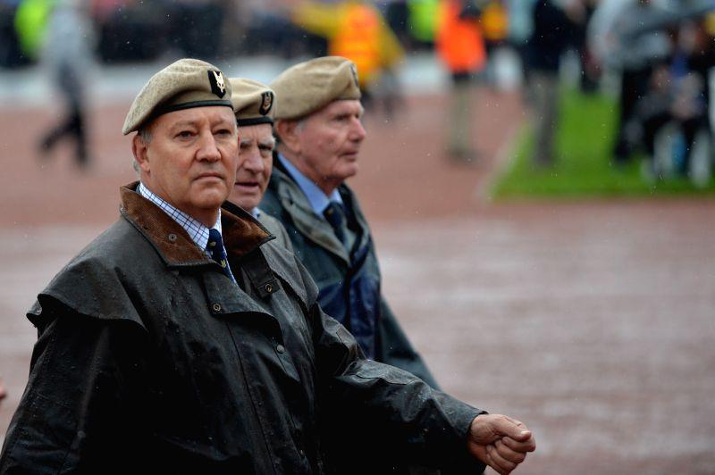 CANBERRA, April 25, 2017 - Veterans march at the Australian War Memorial on Anzac Day in Canberra, Australia, April, 25, 2017.(Xinhua/Xu Haijing)