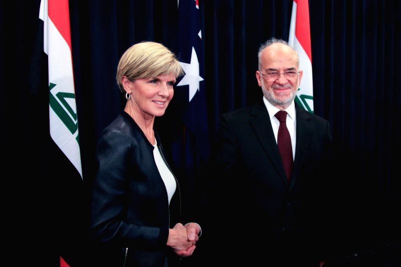 Australian Foreign Minister Julie Bishop (L) shakes hands with her visiting Iraqi counterpart Ibrahim Al-Jaafari after a joint press conference in Canberra Feb. ... - Julie Bishop