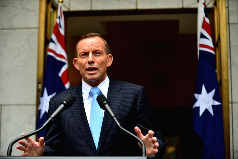 Australian Prime Minister Tony Abbott speaks at Prime Minister's courtyard after the leadership spill motion was defeated at the Parliament House earlier Monday in . - Tony Abbott