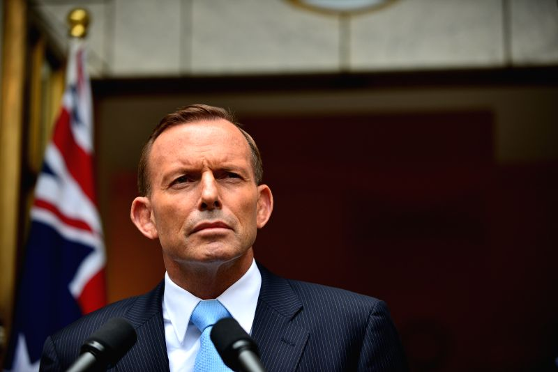 Australian Prime Minister Tony Abbott speaks at the Prime Minister's courtyard after the leadership spill motion was defeated at the Parliament House earlier Monday - Tony Abbott