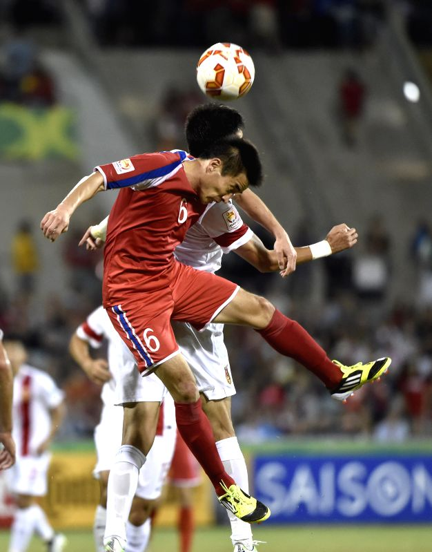 Ro Hak-su (L) of DPRK jumps for the ball during a group B match between China and the Democratic People's Republic of Korea of the AFC Asian Cup in Canberra, ...