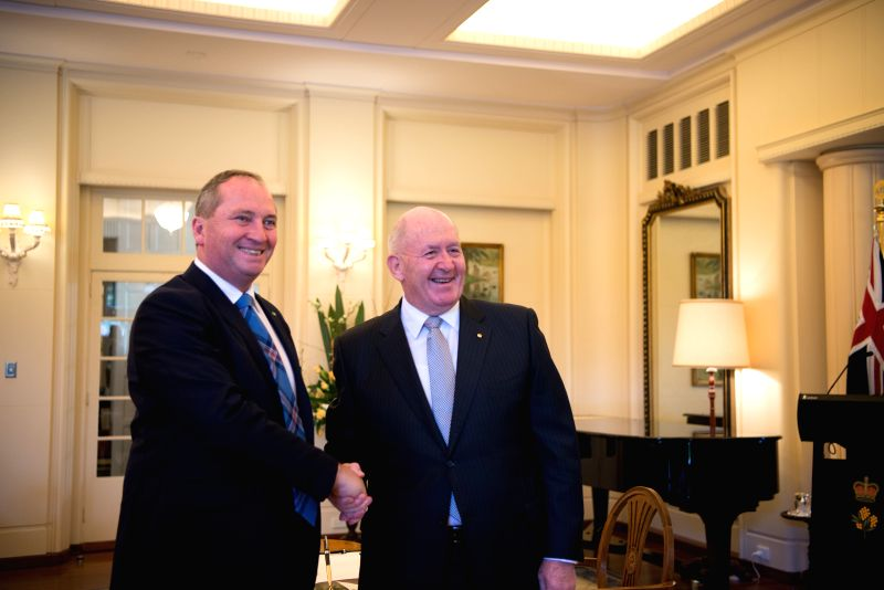 CANBERRA, July 19, 2016 - Barnaby Joyce (L) is sworn in as Deputy Prime Minister and Minister for Agriculture and Water Resources in the Australian cabinet by Governor General Peter Cosgrove at the ...