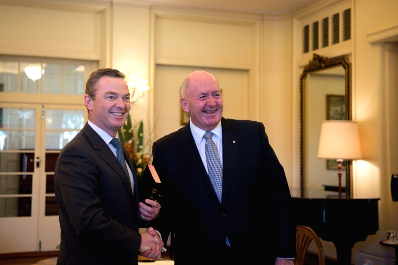 CANBERRA, July 19, 2016 - Christopher Pyne (L) is sworn in as Minister for Defence Industry in the Australian cabinet by Governor General Peter Cosgrove at the Government House in Canberra, ...