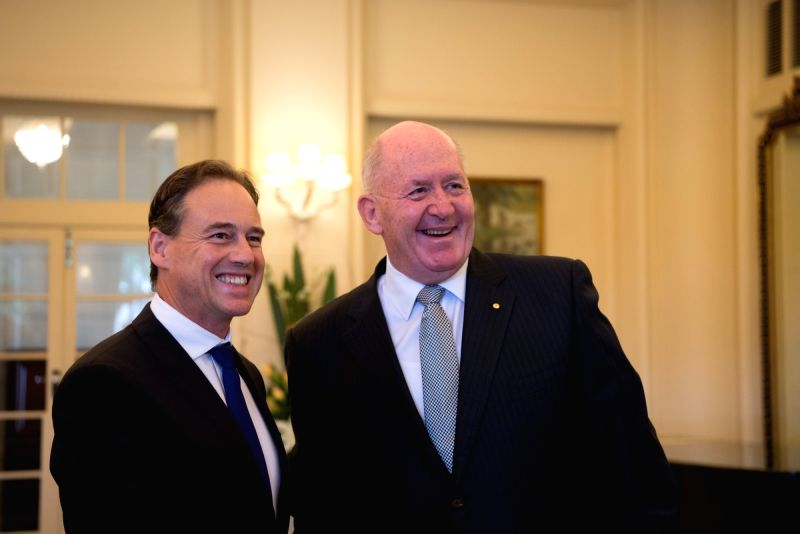 CANBERRA, July 19, 2016 - Greg Hunt (L) is sworn in as Minister for Industry, Innovation and Science in the Australian cabinet by Governor General Peter Cosgrove at the Government House in Canberra, ...