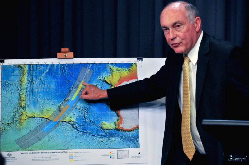Australian Deputy Prime Minister Warren Truss points the new search area for MH370 to reporters at a press conference at Australian Parliament House in Canberra, .. - Warren Truss