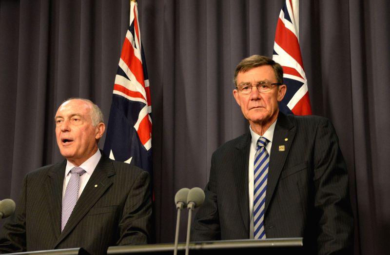 Australian Deputy Prime Minister Warren Truss (L) and Sir Angus Houston, chair of Australia's Air Traffic Control Manager, make an announcement at the Parliament ... - Warren Truss