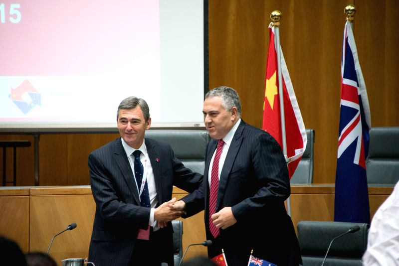 National President of Australian China Business Council (ACBC) John Brumby (L) and Australian Treasurer Joe Hockey attend the launching meeting of ACBC's 2014 ...
