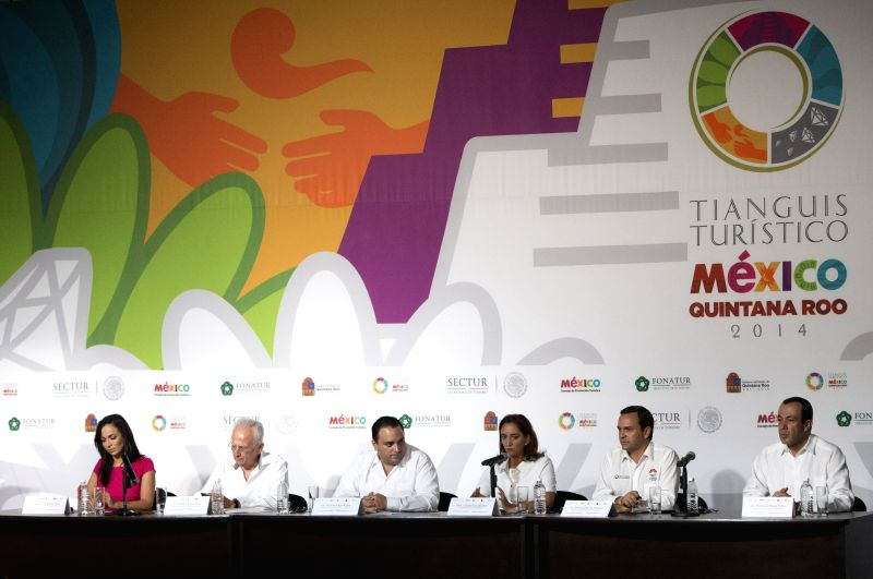General Director of Mexico's Tourism Promotion Council, Rodolfo Lopez Negrete (2nd L), and Mexico's Tourism Secretary, Claudia Ruiz Massieu Salinas (3rd R), attend ...