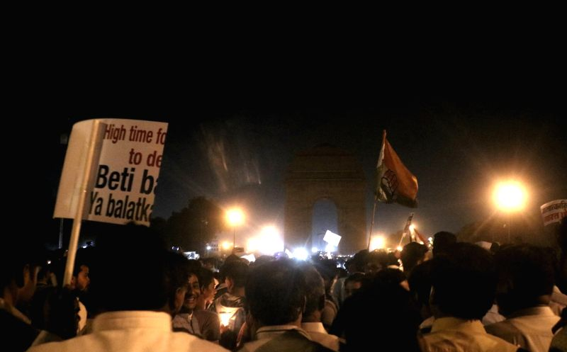 Candles lit by Congress workers at India Gate during a candlelight vigil called by party president Rahul Gandhi to protest against incidents of rape in Unnao (Uttar Pradesh) and Kathua ... - Rahul Gandhi