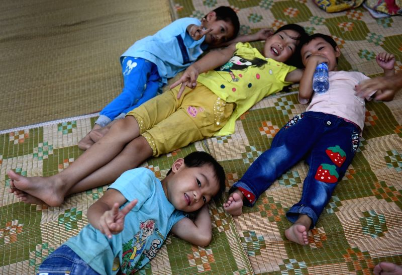 CANGWU, Aug. 3, 2016 - Children rest at a relocation site at the primary school of Cantian Village, Cangwu County of south China's Guangxi Zhuang Autonomous Region, Aug. 2, 2016. Typhoon Nida hit ...