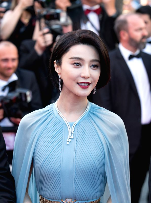 CANNES (FRANCE), May 17, 2017 Jury member for the 70th Cannes International Film Festival, Chinese actress Fan Bingbing poses on the red carpet at the opening of the 70th Cannes ... - Fan Bingbing
