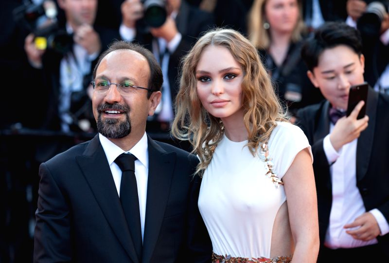 CANNES (FRANCE), May 18, 2017 Iranian director Asghar Farhadi (L) and U.S. actress Lily-Rose Depp pose on the red carpet before the opening of the 70th Cannes International Film Festival ... - Asghar Farhadi