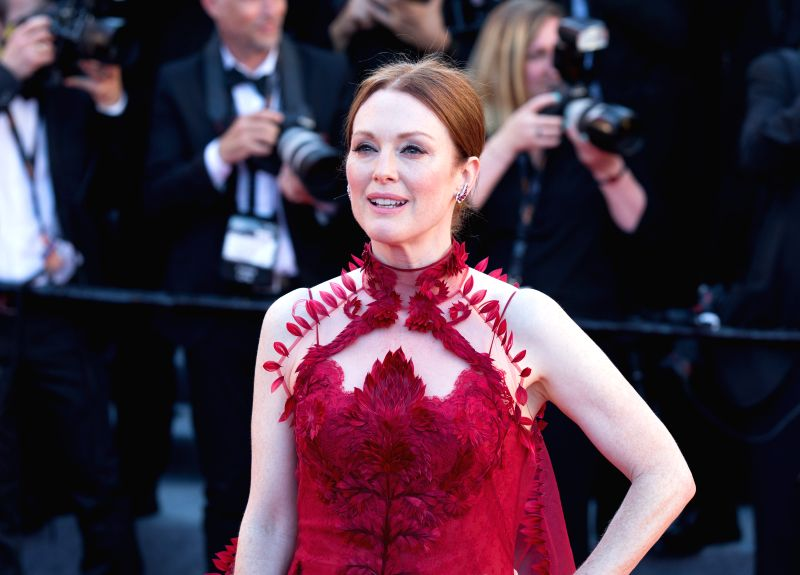 CANNES (FRANCE), May 18, 2017 U.S. actress Julianne Moore poses on the red carpet before the opening of the 70th Cannes International Film Festival in Cannes, France, on May 17, 2017. The ... - Julianne Moore