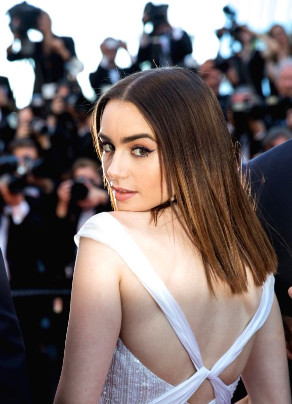 "CANNES (FRANCE), May 19, 2017 British actress Lily Collins poses on the red carpet for the screening of the film ""Okja"" in competition at the 70th Cannes International Film ... - Lily Collins"