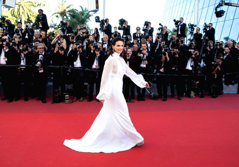 "CANNES (FRANCE), May 19, 2017 French actress Juliette Binoche poses on the red carpet for the screening of the film ""Okja"" in competition at the 70th Cannes International Film ... - Juliette Binoche"