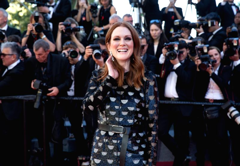 "CANNES (FRANCE), May 19, 2017 U.S. actress Julianne Moore poses on the red carpet for the screening of the film ""Okja"" in competition at the 70th Cannes International Film ... - Julianne Moore"