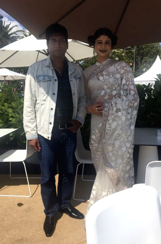 Cannes (France): World News Network Managing Director Satish Reddy with actress Pooja Batra at 69th Cannes Film Festival in France. - Pooja Batra and Satish Reddy